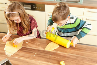 Children baking cookies in the kitchen