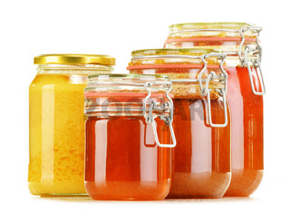 Composition with jars of honey isolated on white background