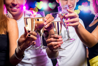 Group of people with glasses of sparkling champagne over abstract background