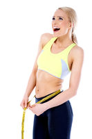 Happy Fit Young Woman Measuring Waist Line