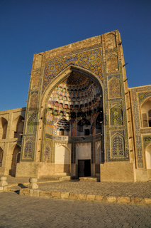 Picturesque view of the Abdulaziz Khan Madrassah (Museum of Wood Carving Art) in the setting sun
