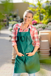 Garden center woman worker posing in apron