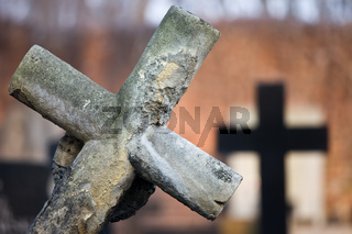 Leaning Cross at Cemetery
