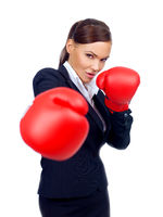 Determined businesswoman throwing a punch