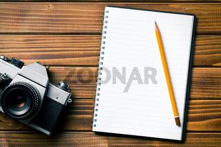 retro camera with notebook