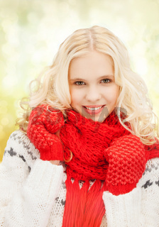 teenage girl in red mittens and scarf