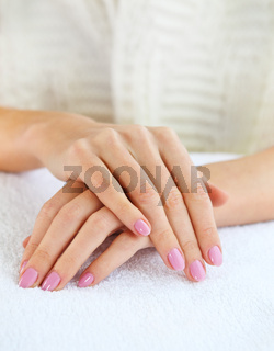 Close up shot of nicely manicured woman fingernails