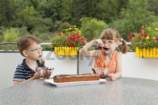 Kids decorating the chocolate cake