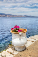 Flower pot over Aegean Sea in Greece