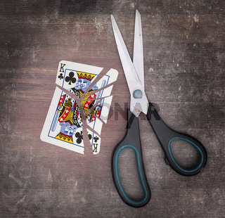 Concept of addiction, card with scissors
