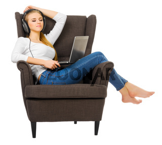 Young girl listen music on chair isolated