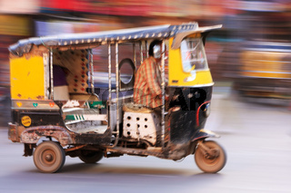Autorickshaw in the street of Sadar Market, blurred motion, Jodhpur, India
