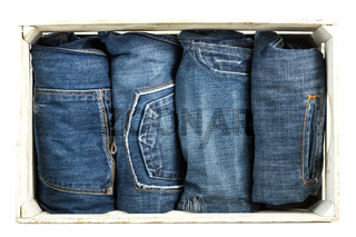 Blue Jeans over wooden background