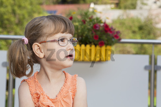 Little girl looks up concentrated