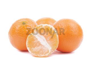 Fresh ripe tangerines on a white background.