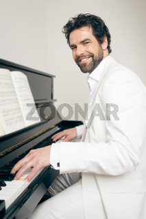 man with piano