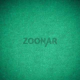 Closeup of green fabric textile material as texture or background