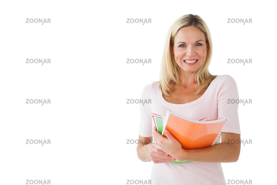 Happy mature student holding notebooks