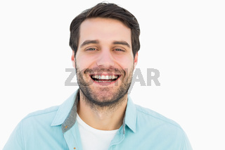 Happy casual man smiling at camera