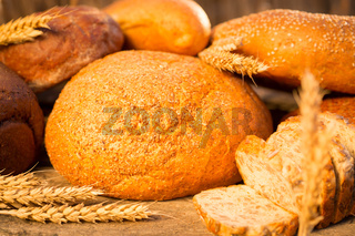 Homemade bread and wheat on the wooden table