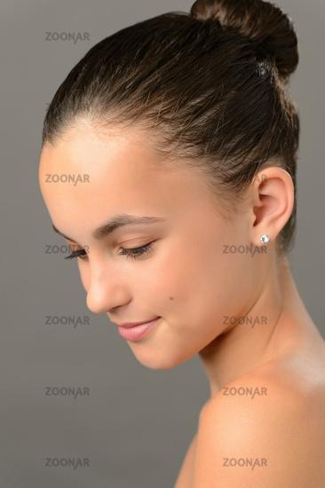Teenage girl purity skin beauty looking down