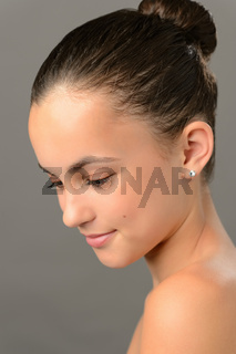 Teenage girl purity skin beauty looking down