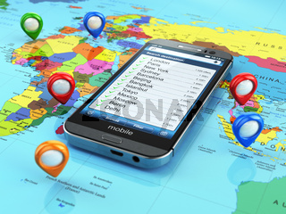 Travel destination and tourism concept. Smartphone on world map and pins.