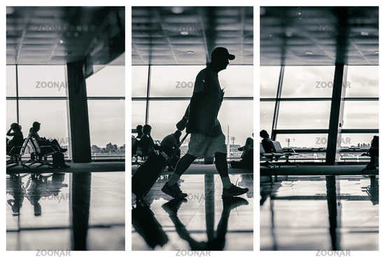Silhouette of man at the airport with luggage