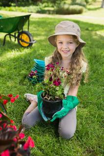 Smiling girl engaged in gardening