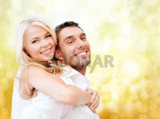 happy couple having fun over lights background