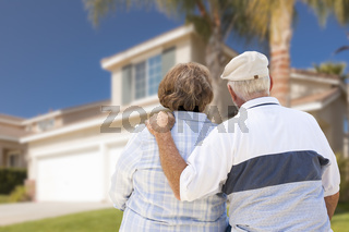 Happy Senior Couple Looking at Front of House