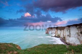 sunrise over cliffs in Atlantic ocean