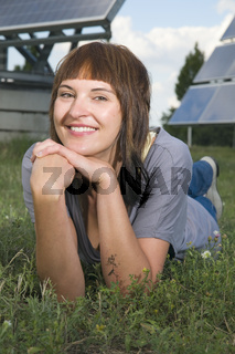 smiling woman between photovoltaics