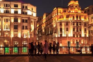 shanghai bund at night with tourists