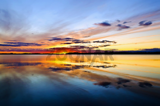 Sun goes to bed. Lake Pongomozero, North Karelia, Russia