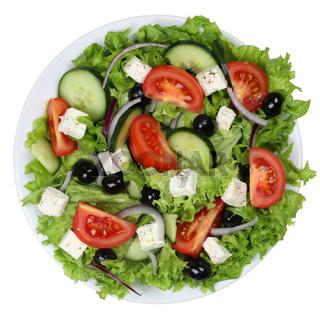 Griechischer Salat mit Tomaten, Feta Käse und Oliven auf Teller von oben