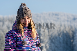 Young woman portrait winter mountains snow