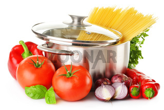 Stainless pot with spaghetti and variety of raw vegetables isolated on white