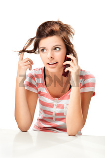 young woman with cellphone isolated on white