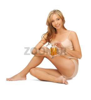 woman in cotton undrewear with oil bottle
