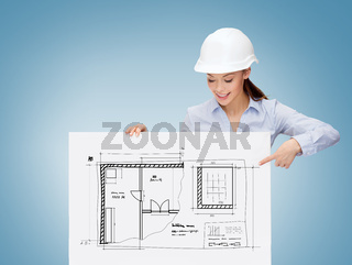businesswoman in helmet pointing finger to board