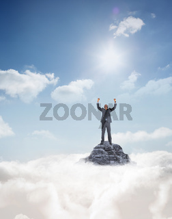 Composite image of happy businessman cheering