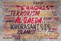 Konzept zu ISIS und Al-Qaeda an Wand
