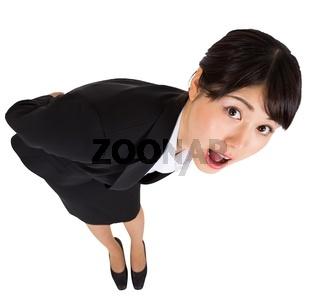 Surprised businesswoman bending