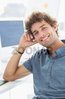 Smiling casual young man in office