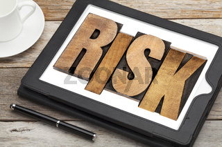 risk - word on digital tablet
