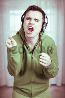 Crazy man with headphones singing