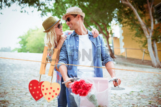Composite image of hip young couple going for a bike ride