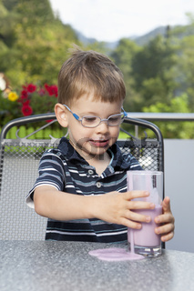 Little boy with spilled drink