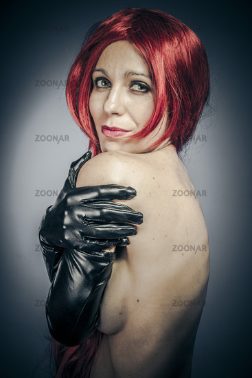 Studio, Sexy red hair woman with latex gloves